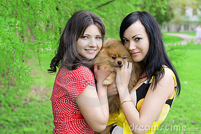 Girls with a dog in the park