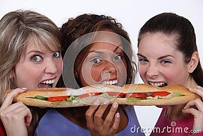 Girls eating a sandwich