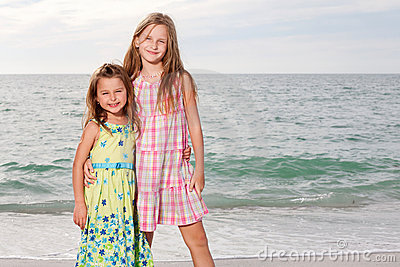 Girls enjoy summer day at the beach.