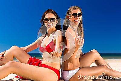 Girls enjoying freedom on the beach