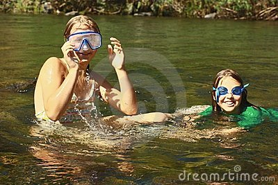Girls enjoying the river water