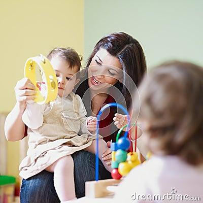 Girls and female teacher in kindergarten