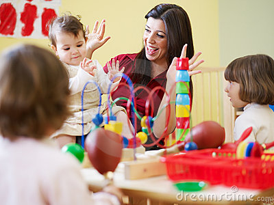 Girls and female teacher in kindergarten