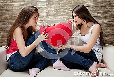 Girls fight on pillows