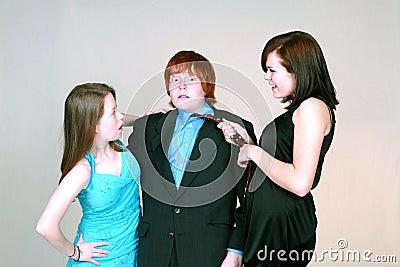 Girls fighting over blushing boy
