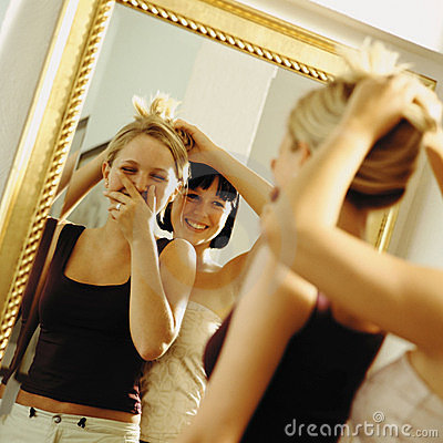 Girls in front of mirror