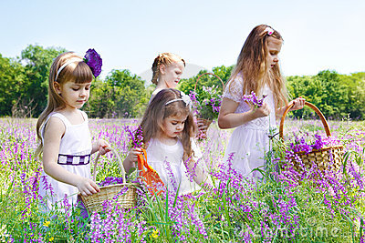 Girls gathering flowers