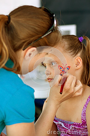 Girls Gets Face Painted At Festival Editorial Photography