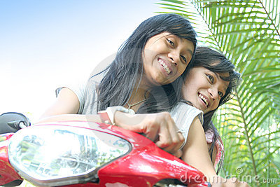 Girls having fun on bike