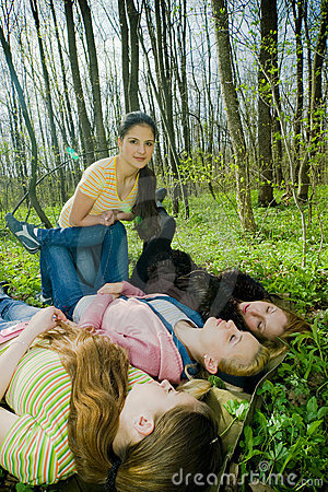 Girls having fun in the forest