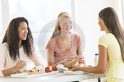 Girls Having Snacks In University Canteen