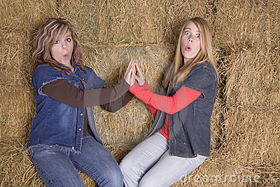 Girls on hay surprised