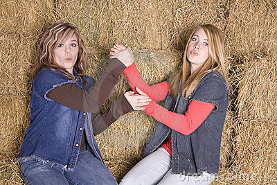 Girls on haystack having fun