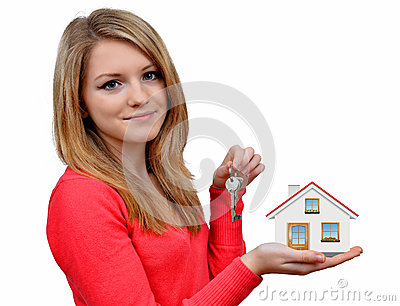 Girls holding in hands house