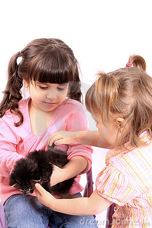 Girls holding kitten