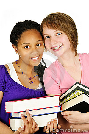 Girls holding text books