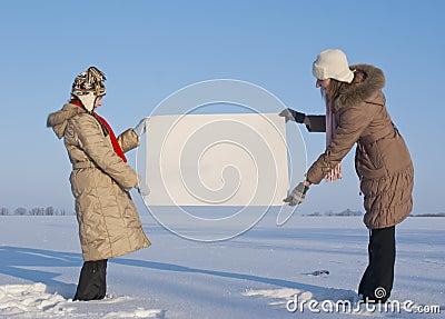 Girls holding white poster