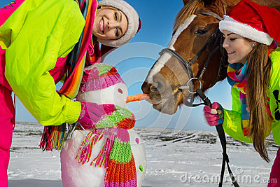 Girls with horse and snowman