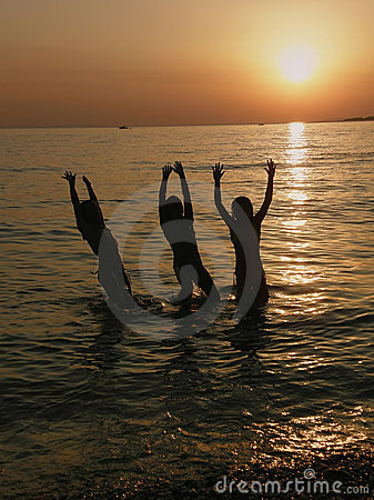 Free Girls Jumping In The Sea In Sunset Royalty Free Stock Photography - 13376297
