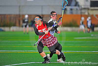 Girls Lacrosse eye on the ball Editorial Stock Photo