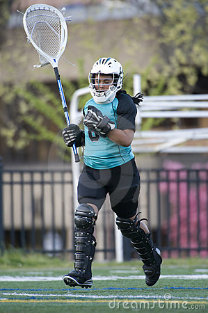 Girls lacrosse goalie taking the field