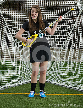 Girls Lacrosse player goofing around in the gate