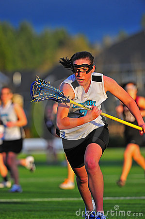 Girls Lacrosse race after the ball Editorial Photo