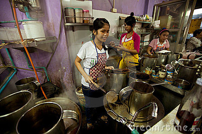 Girls from Lao working on the Bangkok kitchen Editorial Stock Photo