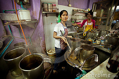 Girls from Lao working on the kitchen Editorial Image