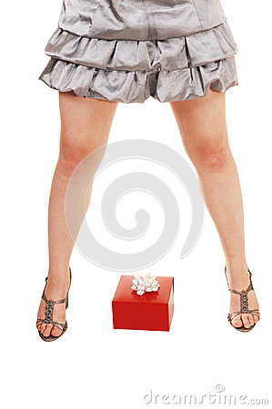 Girls legs with gift.
