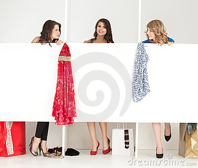 Girls looking clothes in wordrobe