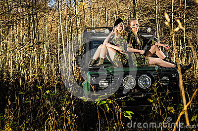 girls and off road vehicle stock image image 37280571. Black Bedroom Furniture Sets. Home Design Ideas