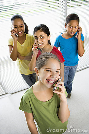 Free Girls On Cell Phones. Stock Image - 3421611