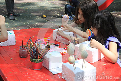 Girls painting easter eggs Editorial Photo