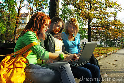 Girls in park with laptop