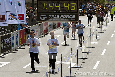 Girls passes the finish line Editorial Image