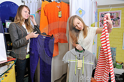 Girls pick out clothes to buy