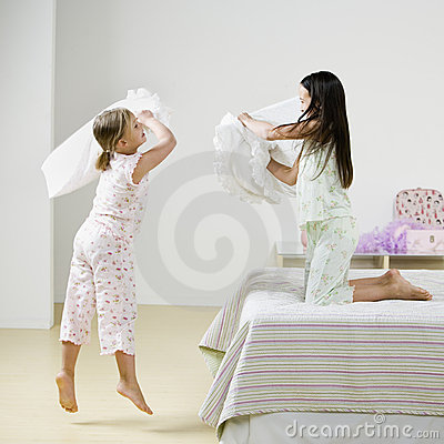 Free Girls Pillow Fighting Stock Photography - 3313482