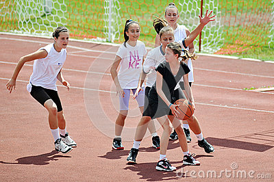 Girls play basketball outside Editorial Stock Photo