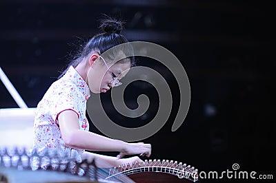 Girls play the Guzheng Editorial Image