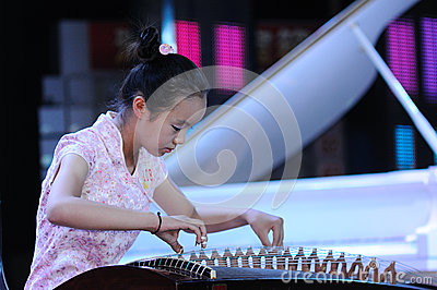 Girls play the Guzheng Editorial Stock Photo