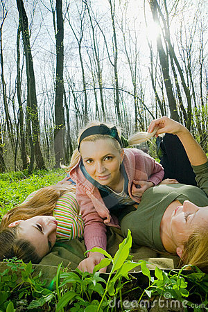 Girls playing in the forest