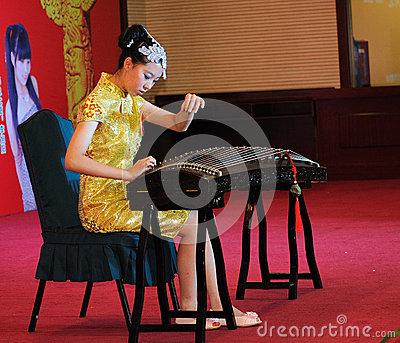 Girls in playing the guzheng Editorial Stock Photo