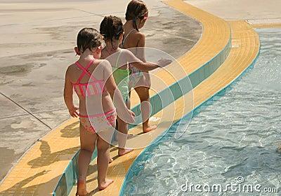 Girls playing at pool