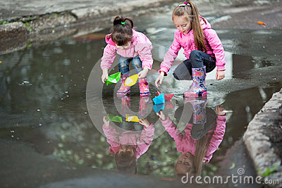 Girls playing in puddle