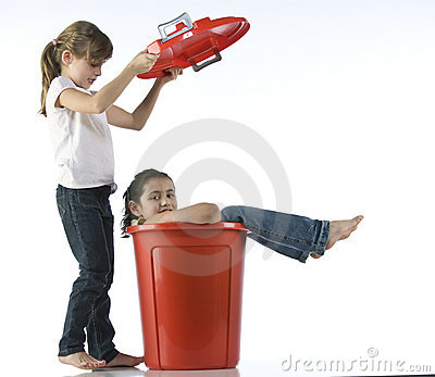 Girls playing with red bin