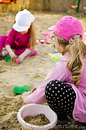 Girls playing in sandbox