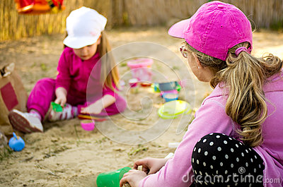 Girls playing in sandbox