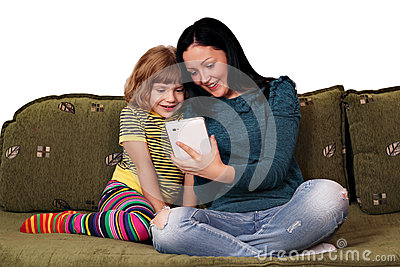 Girls playing with tablet pc