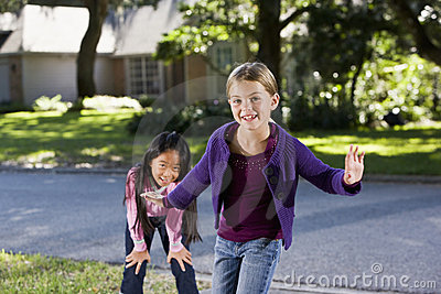 Girls playing together outside home